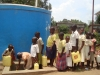 children-line-to-fetch-water-from-the-tank